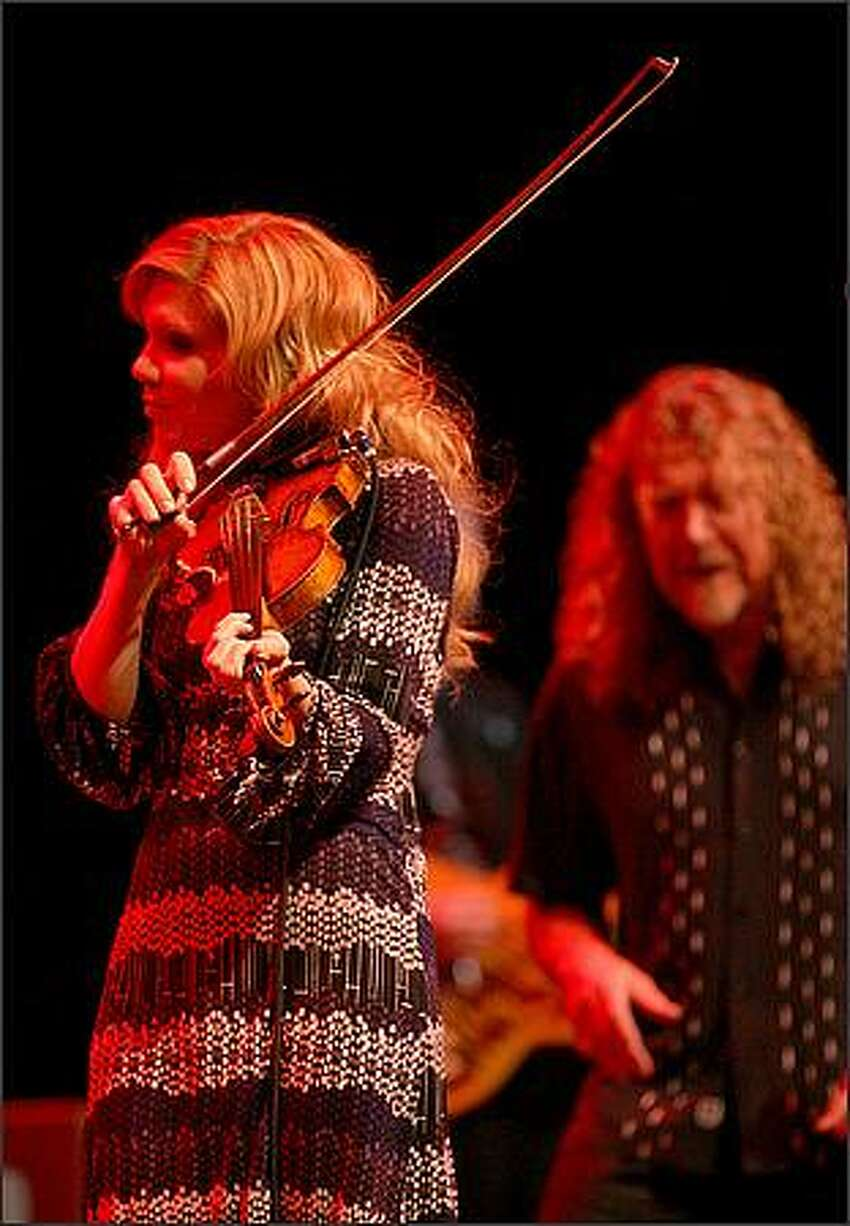 Robert Plant and Alison Krauss perform together at the WaMu Theater in Seattle on Wednesday.