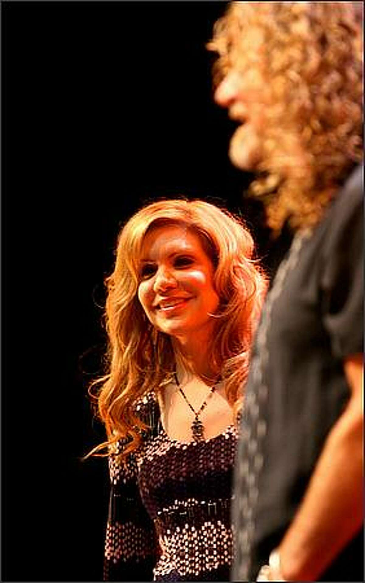 Alison Krauss smiles at the crowd while performing with Robert Plant at the WaMu Theater in Seattle on Wednesday.