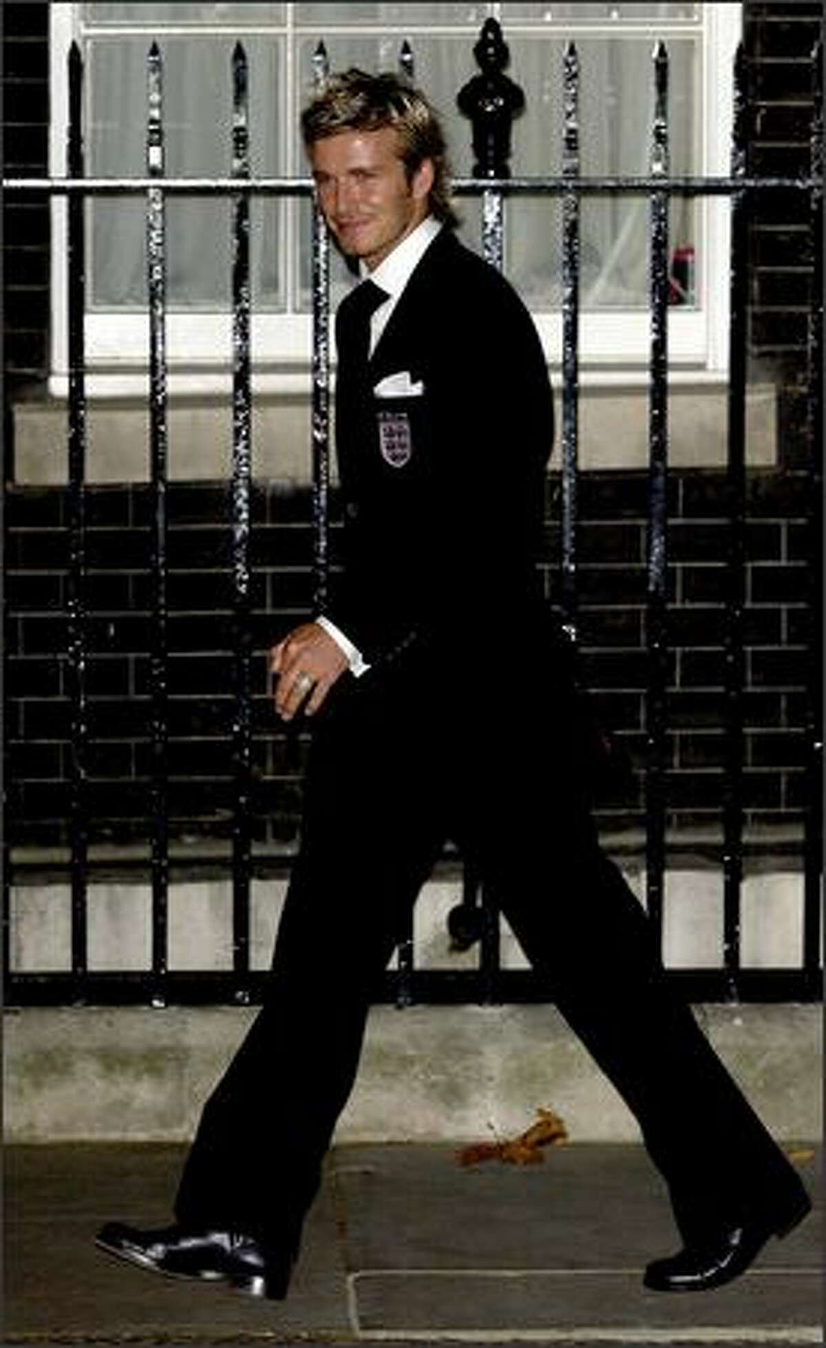 David Beckham attends an evening reception for the England World Cup squad, hosted by British Prime Minister Tony Blair, at 10 Downing Street in London, Oct. 8, 2002.