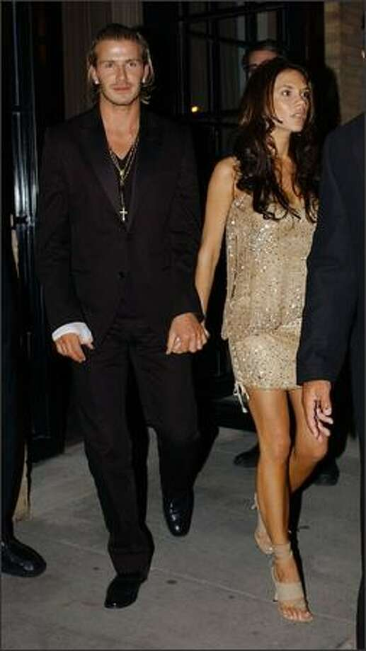David Beckham and his wife Victoria leaves the Soho Club after a Vogue magazine party in New York, May 29, 2002. Photo: Getty Images