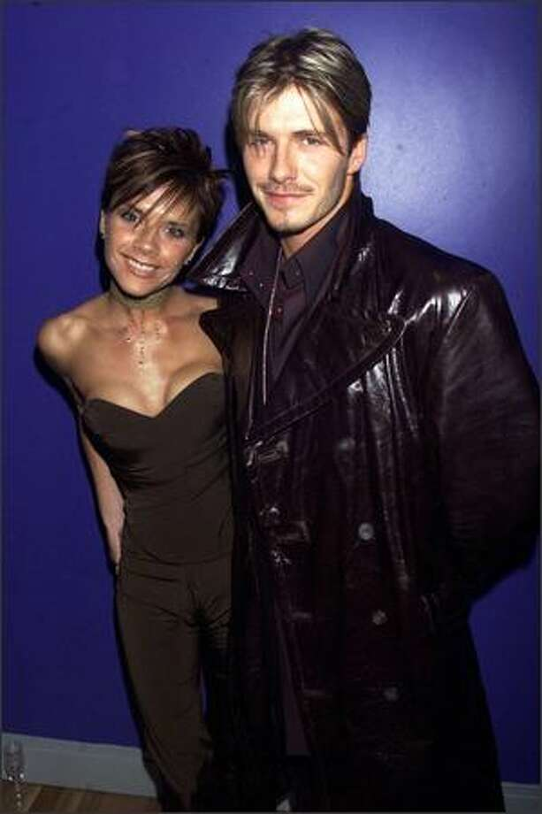 "David Beckham with Victoria attend the charity premiere of ""Withnail and I"" in London's West End on Feb. 7, 2000. Photo: Getty Images"