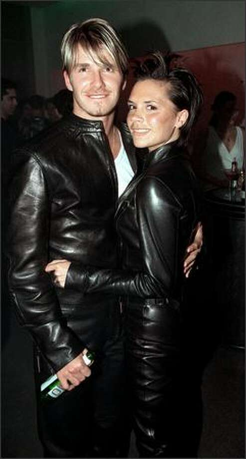 David Beckham and Victoria Adams attend the Versace store opening party in New Bond Street in London on June 11, 1999. Photo: Getty Images