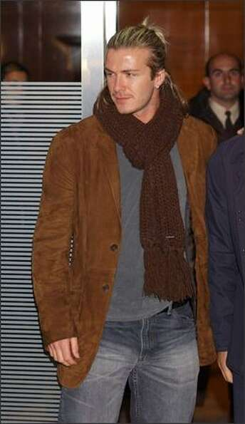 David Beckham visits hospital La Zarzuela in Madrid, Spain to give some presents to children on Dec.