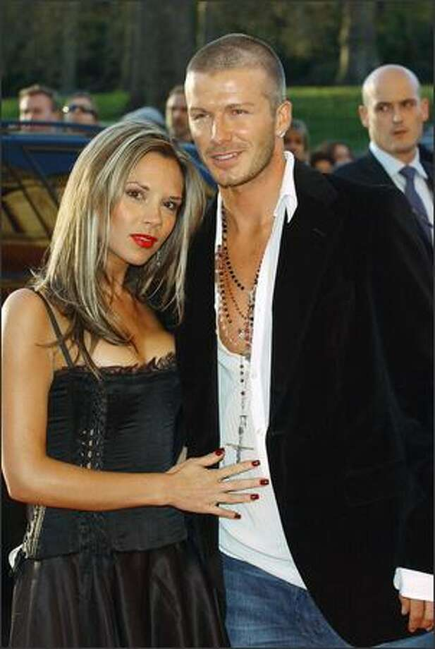 David and Victoria Beckham arrive at 19 Management's 19th Anniversary Party held at the Royal Albert Hall in London on April 19, 2004. Photo: Getty Images