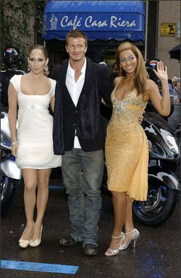Jennifer Lopez, David Beckham and Beyonce Knowles attend the premiere of a new Pepsi advertisement at Circulo de Belles Artes in Madrid, Spain on Feb. 23, 2005. Photo: Getty Images