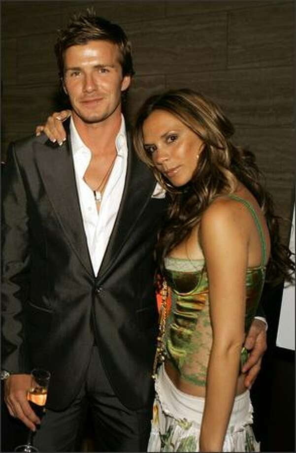 "David Beckham and Victoria Beckham pose at ""The David Beckham Academy"" launch party at Creative Artists Agency on June 3, 2005 in Beverly Hills, Calif. Photo: Getty Images"