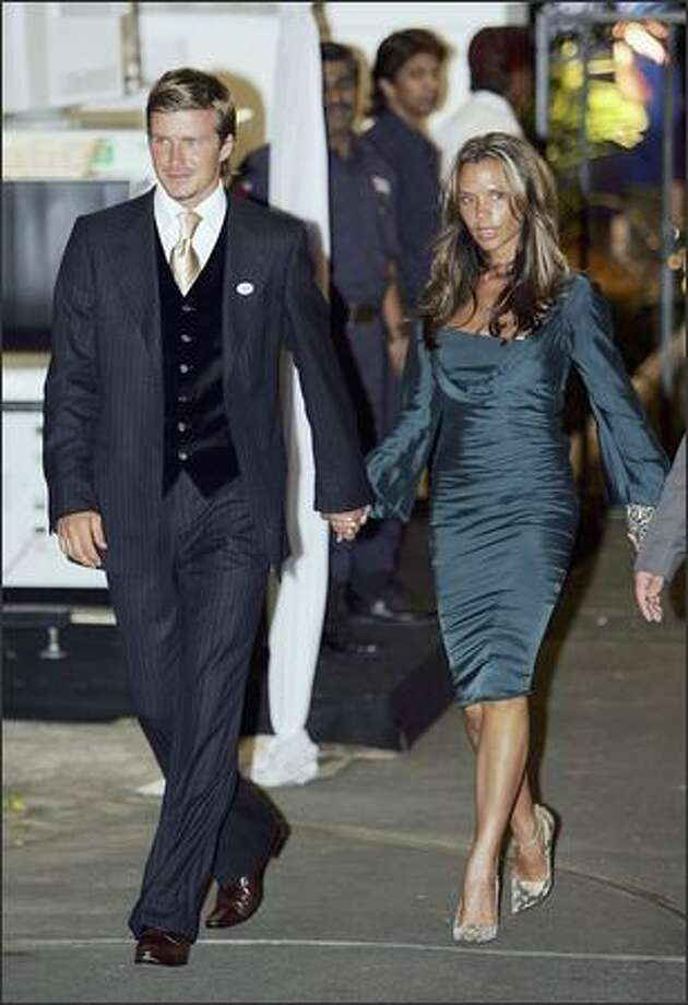 David Beckham and his wife Victoria Beckham leave the British High Commissioner's residence after a dinner reception with British Prime Minister Tony Blair on July 4, 2005 in Singapore. Photo: Getty Images