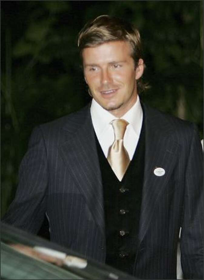 David Beckham leaves the British High Commissioner's residence after a dinner reception with British Prime Minister Tony Blair on July 4, 2005 in Singapore. Photo: Getty Images