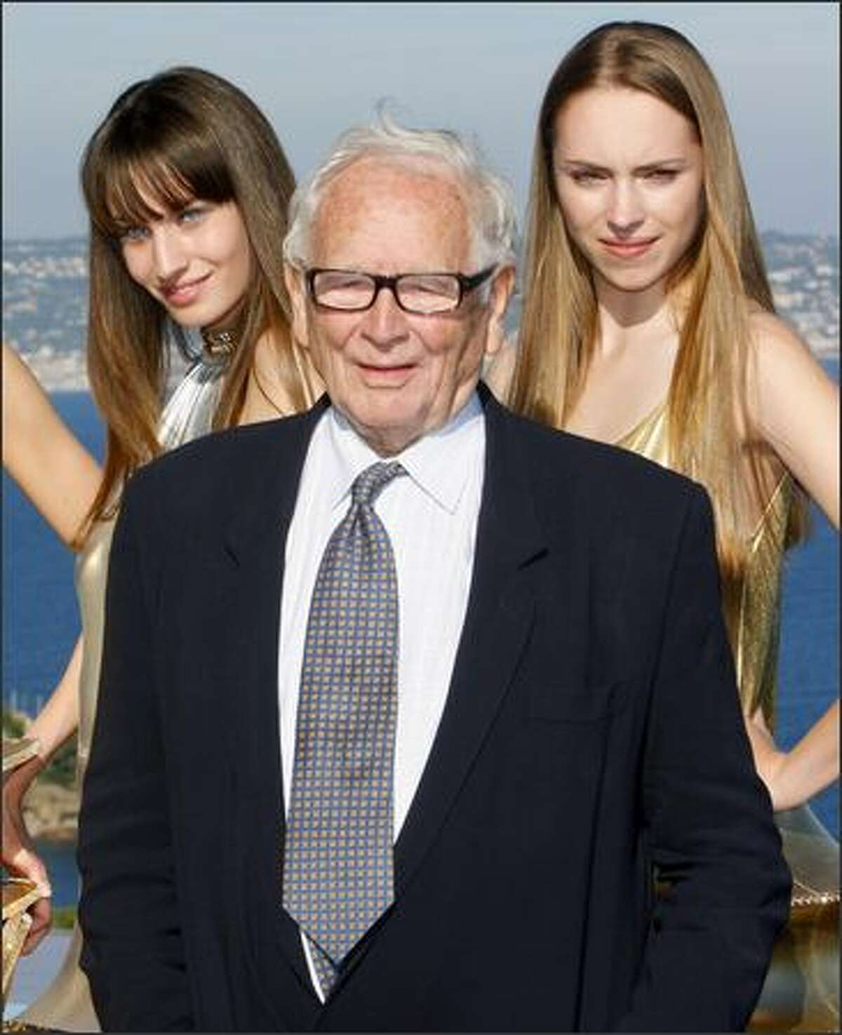 French designer Pierre Cardin poses with models after is spring/summer 2009 ready-to-wear collection show in Theoule-Sur-Mer, southern France, on Monday.