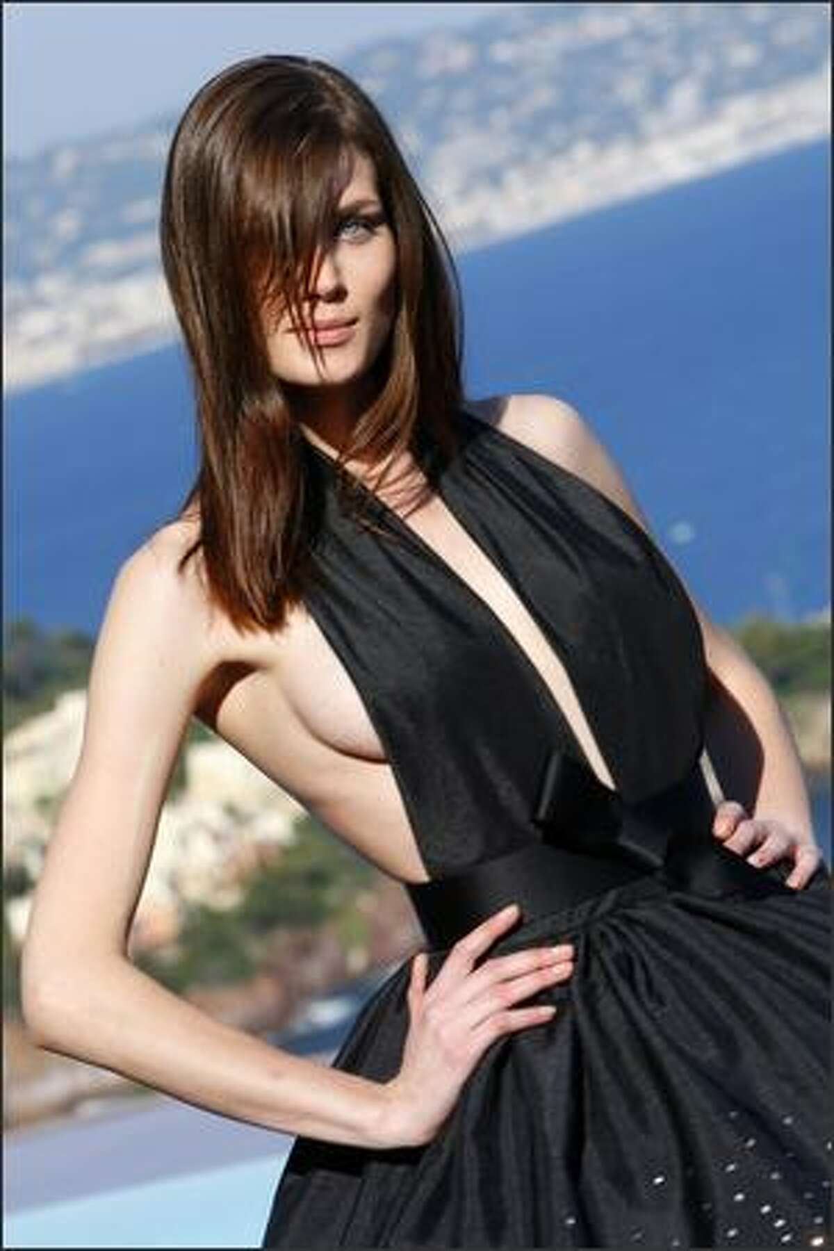 A model presents a creation by French designer Pierre Cardin during the presentation of his entire Spring-Summer 2009 and Autumn-Winter 2009 collections in his own villa in Theoule sur Mer, southern France, on Monday.