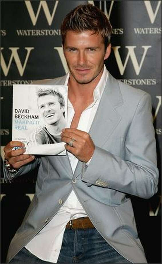 """David Beckham signs copies of his new book """"Making It Real"""" at Waterstones on Oxford Street in London on Sept. 18, 2006. Photo: Getty Images"""