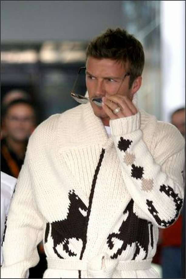 David Beckham arrives at Ciampino Airport for the wedding of Katie Holmes and Tom Cruise  in Rome on Nov. 17, 2006. Photo: Getty Images