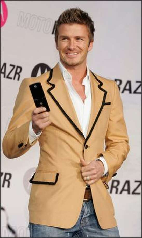 David Beckham attends a mobile phone promotional event at Tokyo's Roponngi Hills on Dec. 29, 2006. Photo: Getty Images