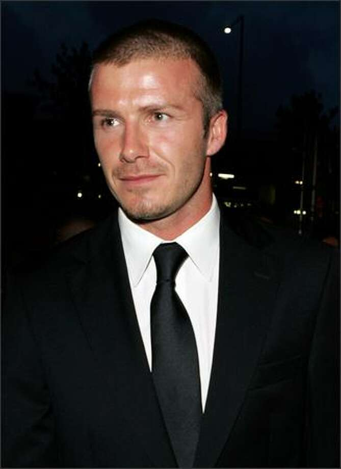 "David Beckham arrives at the ""Foxtel Is Football"" party in his honor in Sydney, Australia on Nov. 26, 2007. Photo: Getty Images"