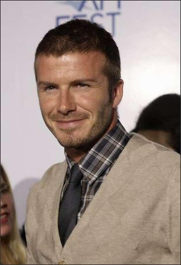 "David Beckham arrives at the AFI Fest 2007 opening night gala premiere of ""Lions For Lambs"" in Hollywood, Calif. on Nov. 1, 2007. Photo: Getty Images"