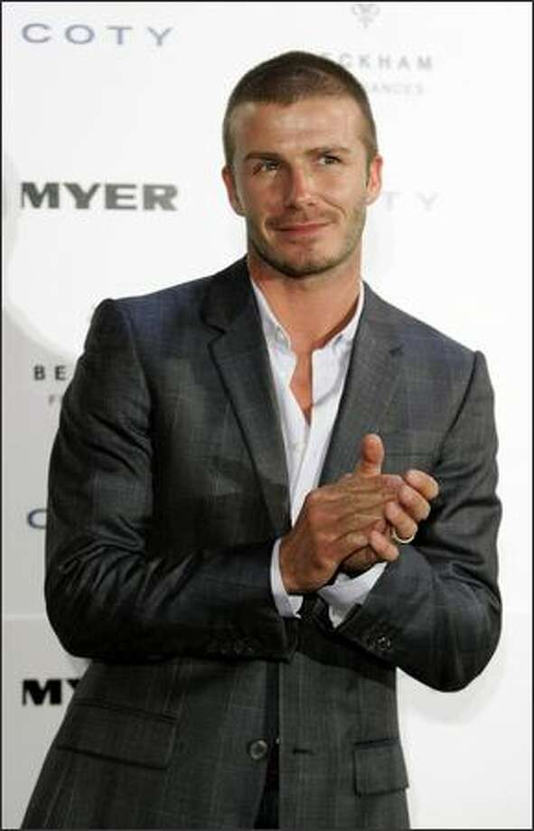 "David Beckham makes a public appearance at Myer Sydney City in Sydney, Australia to promote his new fragrance ""David Beckham Intimately Night"" on Nov. 28, 2007. Photo: Getty Images"