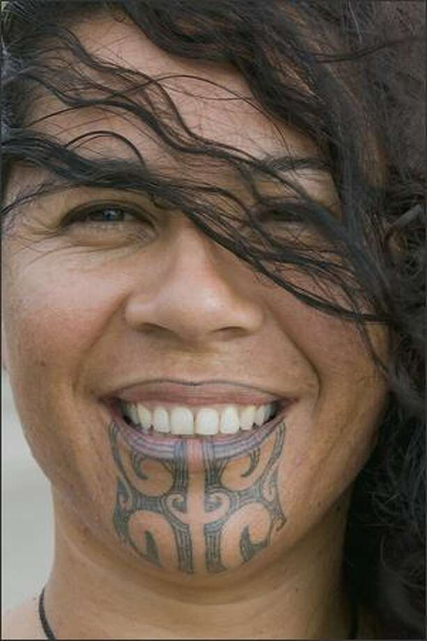 "Art Wolfe's photo of a woman and her tattoo in New Zealand from the TV series ""Art Wolfe's Travels to the Edge."""