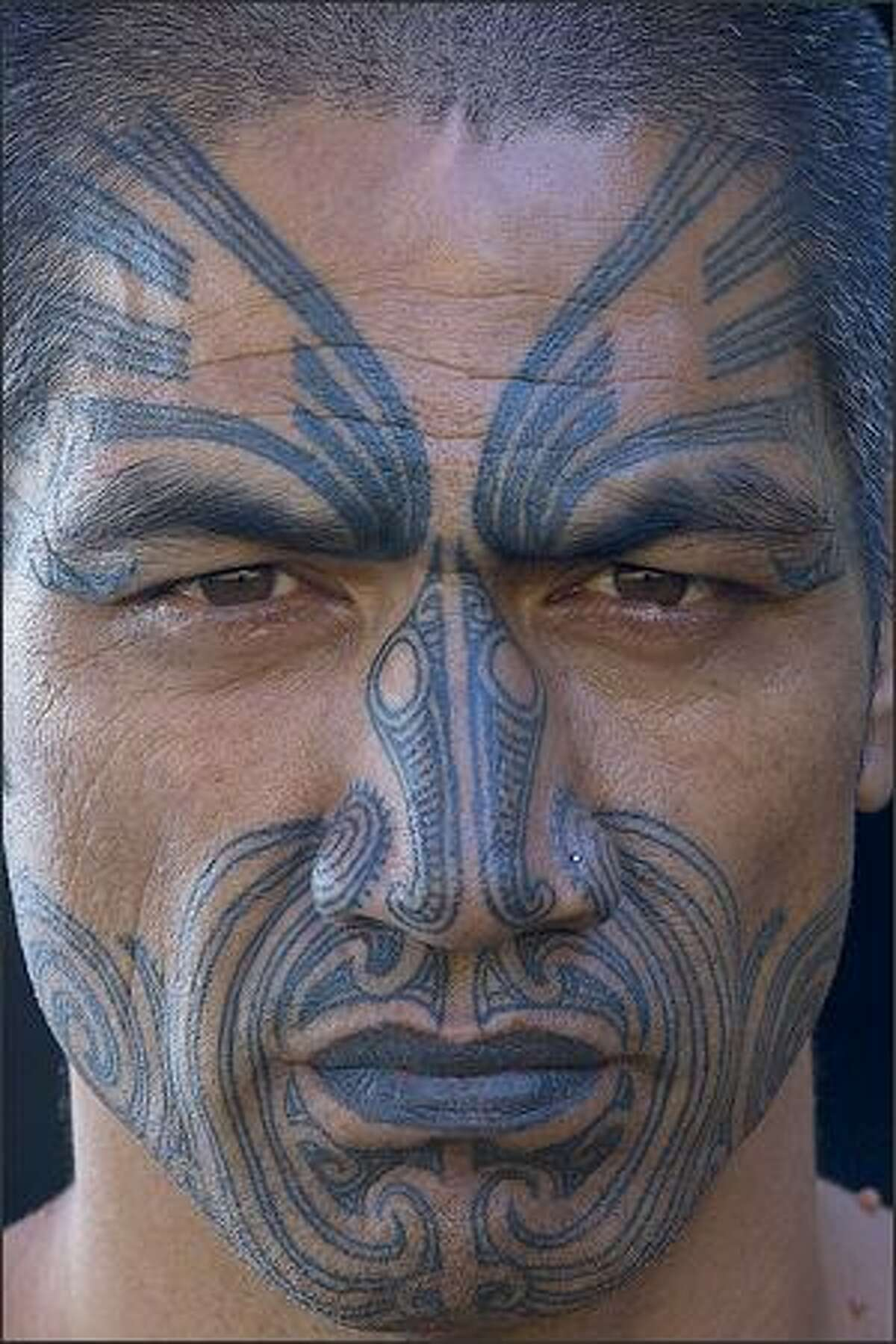Art Wolfe's photo of a man with a traditional tattoo s in New Zealand from the TV series