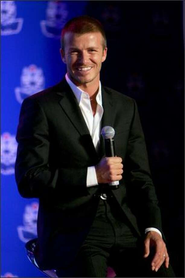 David Beckham answers media questions during a promotional event for Pepsi on March 3, 2008 in Shanghai, China. Photo: Getty Images
