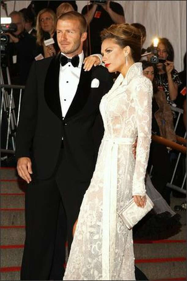 This is the third in an occasional series featuring stars and their ever-changing fashion styles. Soccer star David Beckham of the Los Angeles Galaxy and the England national team (left) and his wife, former Spice Girl Victoria Beckham, arrive at the Metropolitan Museum of Art Costume Institute Gala in New York, May 5, 2008. Photo: Getty Images
