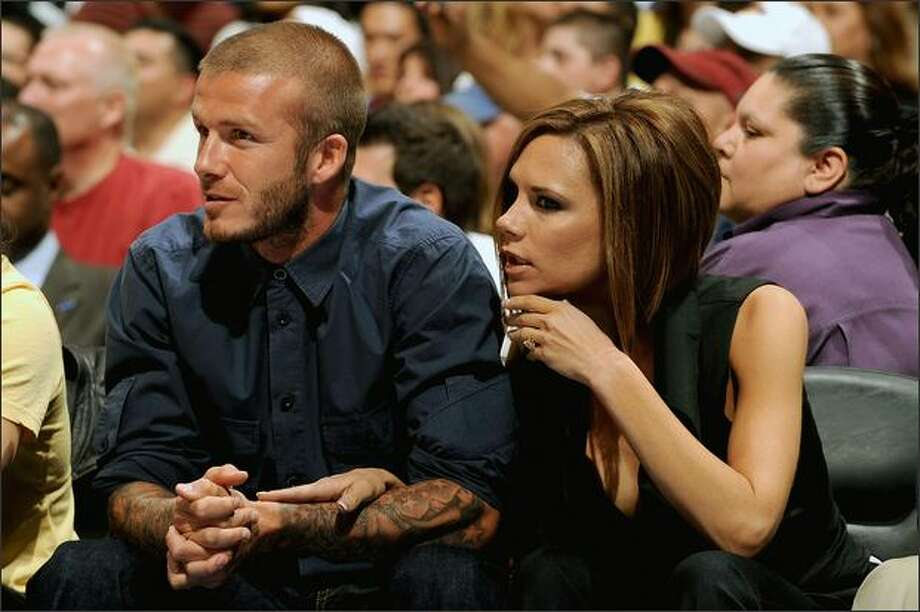 David Beckham and his wife, Victoria Beckham, attend a game between the Los Angeles Lakers and the Los Angeles Clippers at Staples Center in Los Angeles on April 10, 2008. Photo: Getty Images