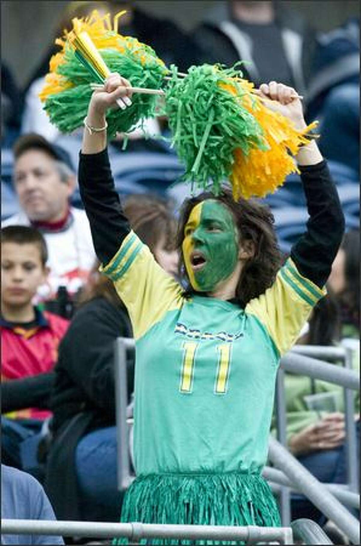 A Brazil fan cheers as she dances for Robinho (11).