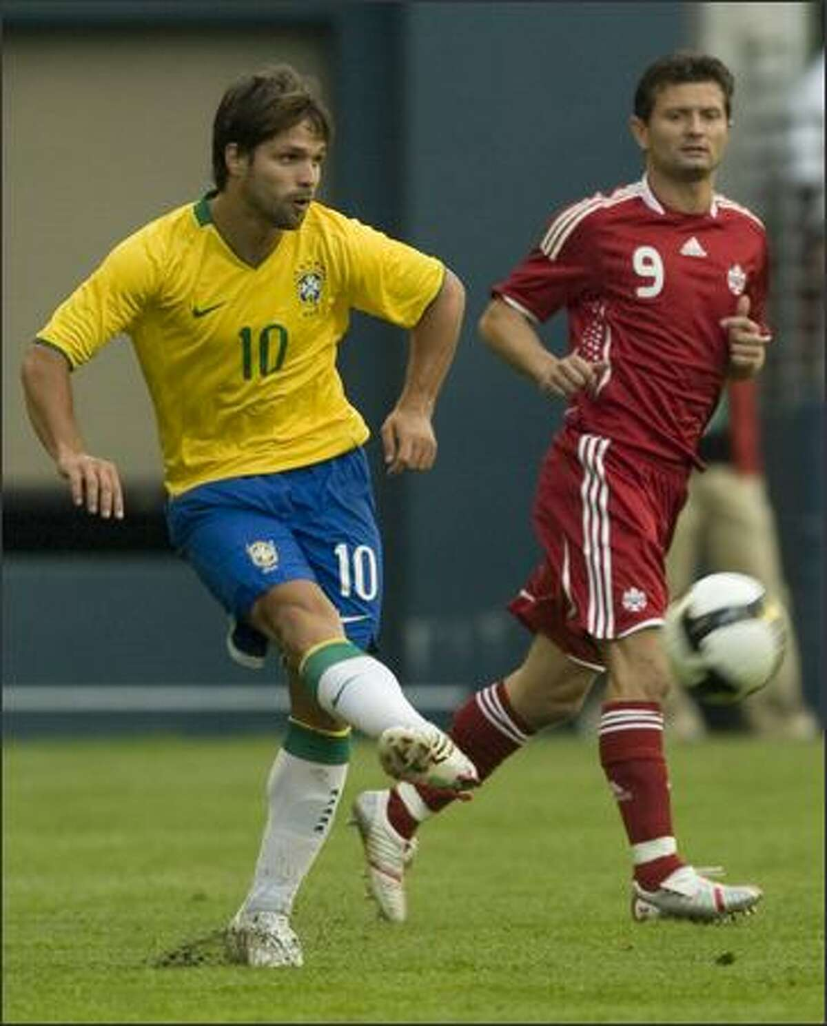Brazil's Diego (10) fires the ball. Canada's Tomasz Radzinski (9) watches.