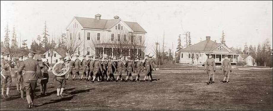 U.S. Army soldiers drill on the parade grounds of Fort Lawton in 1916. Construction of the fort began in 1898 as part of a defense system protecting Puget Sound from naval attack. Although planned as a armed fortification, Fort Lawton had artillery for only a sort time and eventually became an infantry post. In 1970, the fort was turned over to the city, becoming Discovery Park. Photo: P-I File