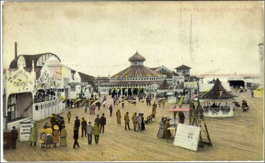Beginning 1907, Luna Park, built on a pier over the tide flats along Duwamish Head in West Seattle, was the Coney Island of the West. The park, shown in this 1910s postcard courtesy of James Johnson, was crowded with rides, amusements, an indoor swimming pool and a bar. However, under the watchful eye of the city's moralists, Luna Park began to fade and was closed in 1913. Photo: P-I File