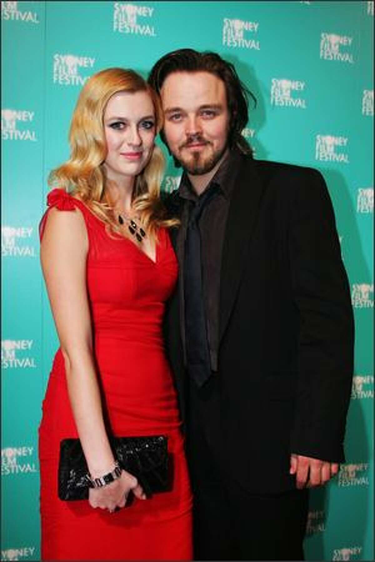 Gracie Otto and Matthew Newton attends the opening gala night and premiere of 'Happy-Go-Lucky' during the 55th Sydney Film Festival at the State Theatre on Wednesday in Sydney, Australia.