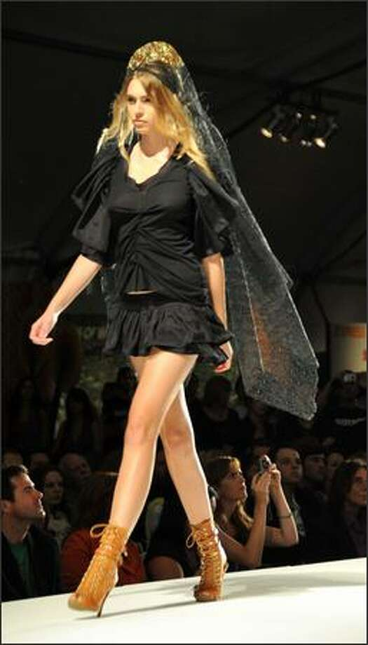 "A Moidel walks the runway at the Gen Art & Soy Joy Presents ""Fashionably Natural"" fashion show to kick of Los Angeles Spring 2009 Fashion week hosted by Maggie Gyllenhaal,  on Thursday at the Petersen Automotive Museum, Los Angeles, Calif. Photo: Getty Images"