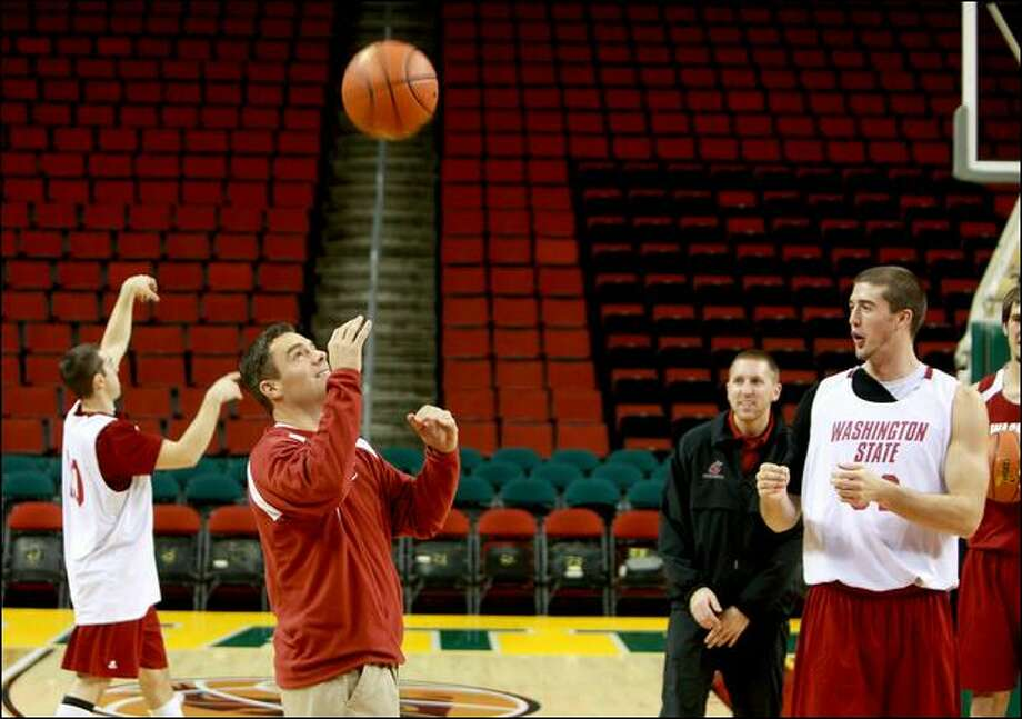 Tony Bennett, center, prepares his team Friday for their game against Montana State at KeyArena. Bennett took the Cougars to the NCAA Sweet Sixteen last season. Photo: Scott Eklund/Seattle Post-Intelligencer