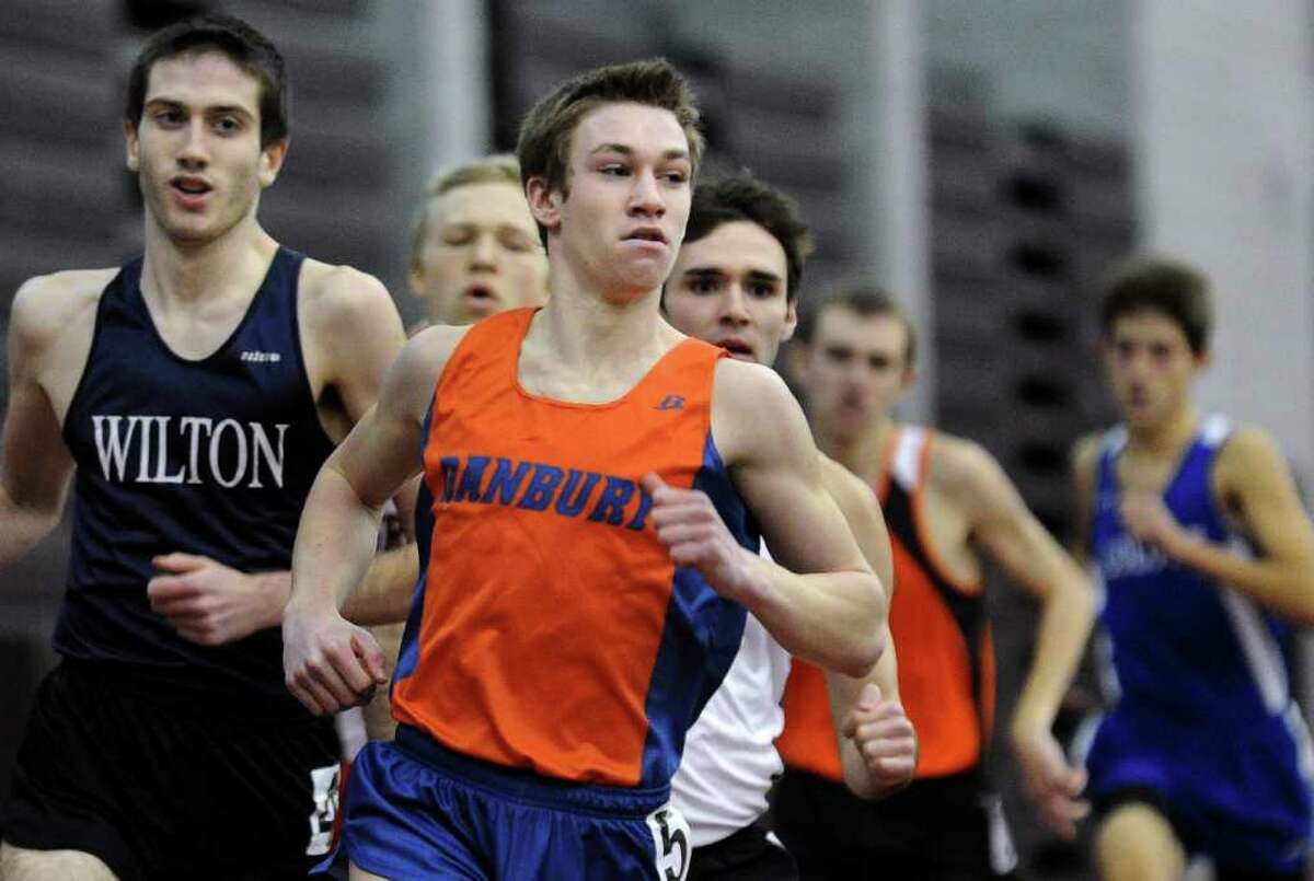 Danbury's Alex Levine competes in the final heat of the 1000 meter run, during FICAC track championship action in New Haven, Conn. on Thursday February 3, 2011. Levine came in first place.