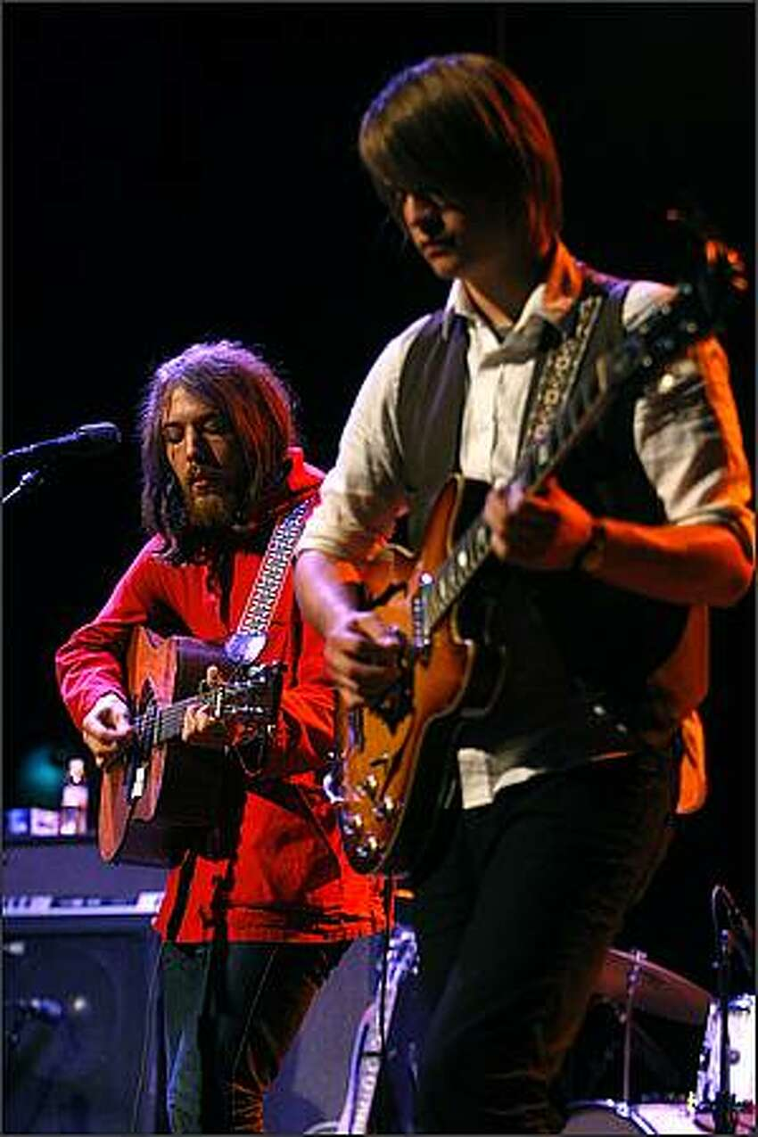 Robin Pecknold, left, and Skye Skjelset, of Fleet Foxes, perform at the Moore Theater in Seattle.