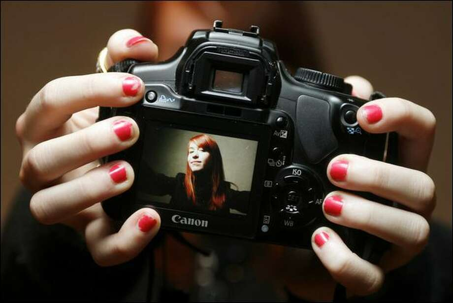 Photographer Chrissie White, 15, shown at her home in the Seattle area, has an online following that posts hundreds of comments for every image on her Flickr photostream. Photo: Mike Urban/Seattle Post-Intelligencer