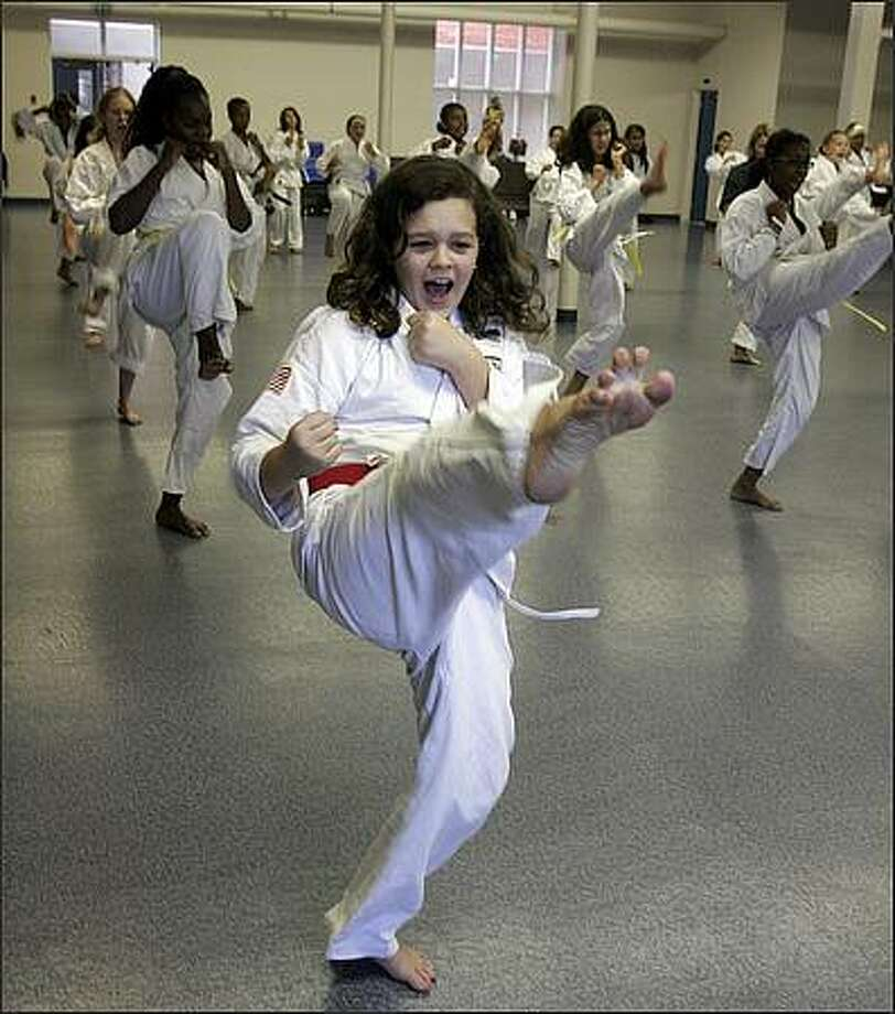 Seventh-grade student Cassandra Gill, who is now a junior black belt, practices with her classmates during gym class at Lake Washington Girls Middle School. Everyone is required to take one term of martial arts per year. Cassandra Gill:   var s117 = new SWFObject('http://blog.seattlepi.nwsource.com/video/mediaplayer.swf','mpl','175','20','7');  s117.addVariable('file','http://blog.seattlepi.nwsource.com/audio/R09_gill.mp3'); s117.addVariable('height','20'); s117.addVariable('width','175'); s117.addVariable('autostart','false'); s117.addVariable('frontcolor','0xffffff'); s117.addVariable('backcolor','0x000000'); s117.addVariable('lightcolor','0xff4109'); s117.write('player117');  Photo: Meryl Schenker, Seattle Post-Intelligencer