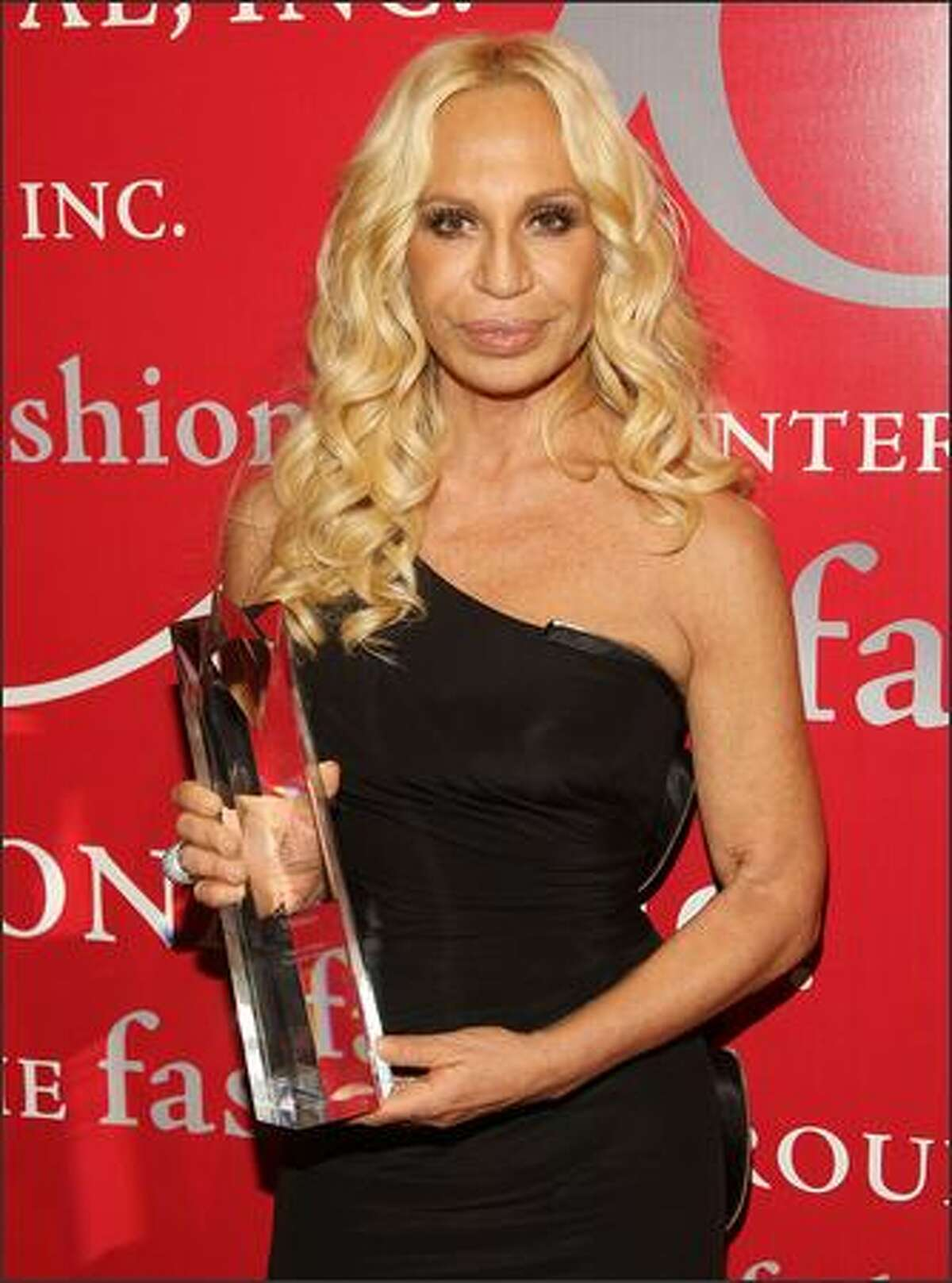 Designer Donatella Versace shows off her