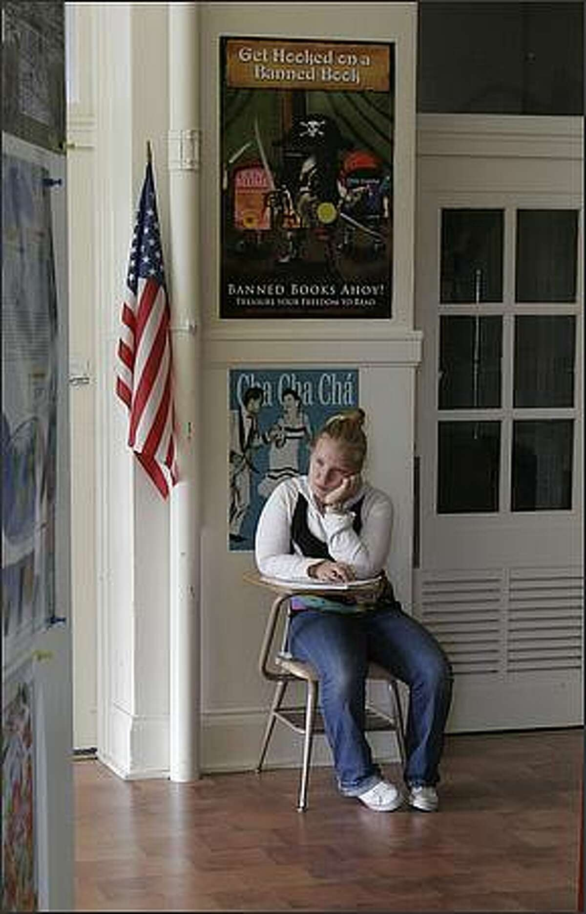 Eighth-grade student Jenalysse Renaud takes a moment to collect herself outside a classroom at Lake Washington Girls Middle School.