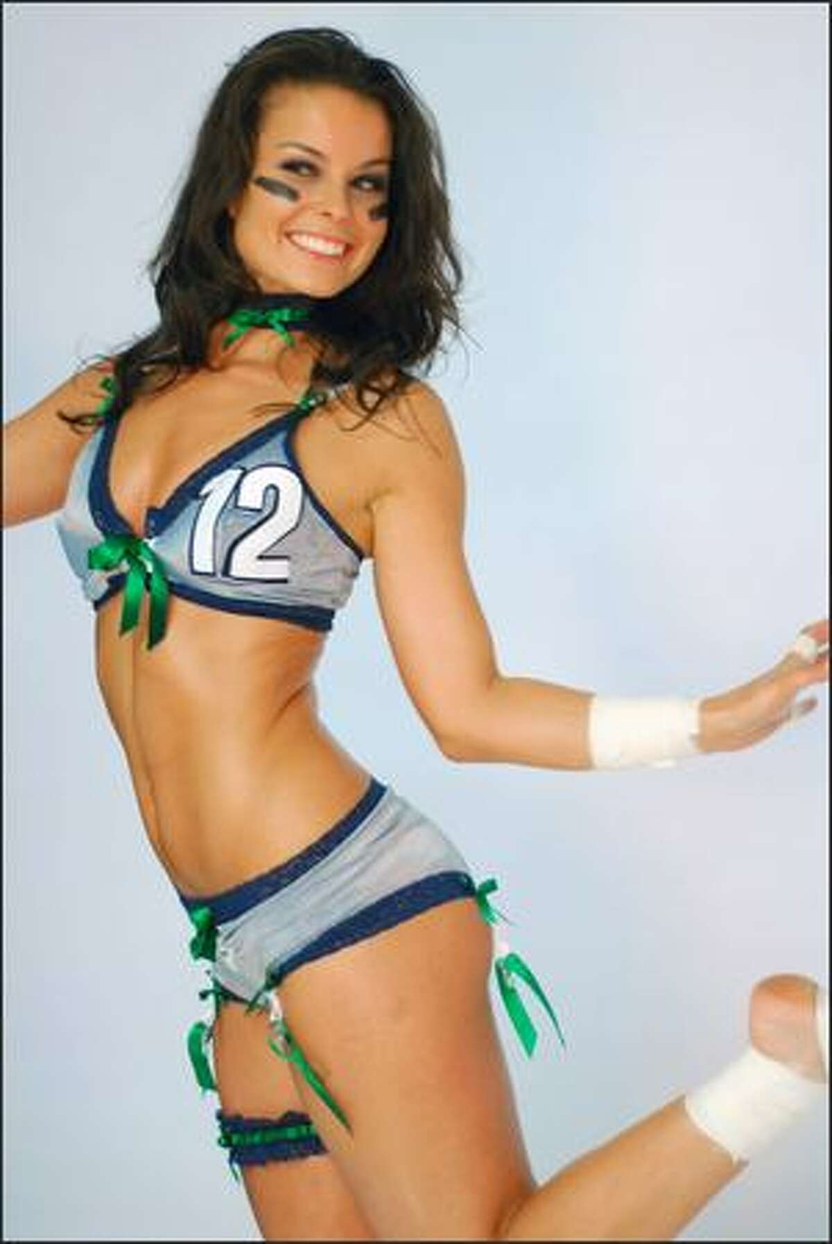 Shannon Sypher cheers after a successful photoshoot.