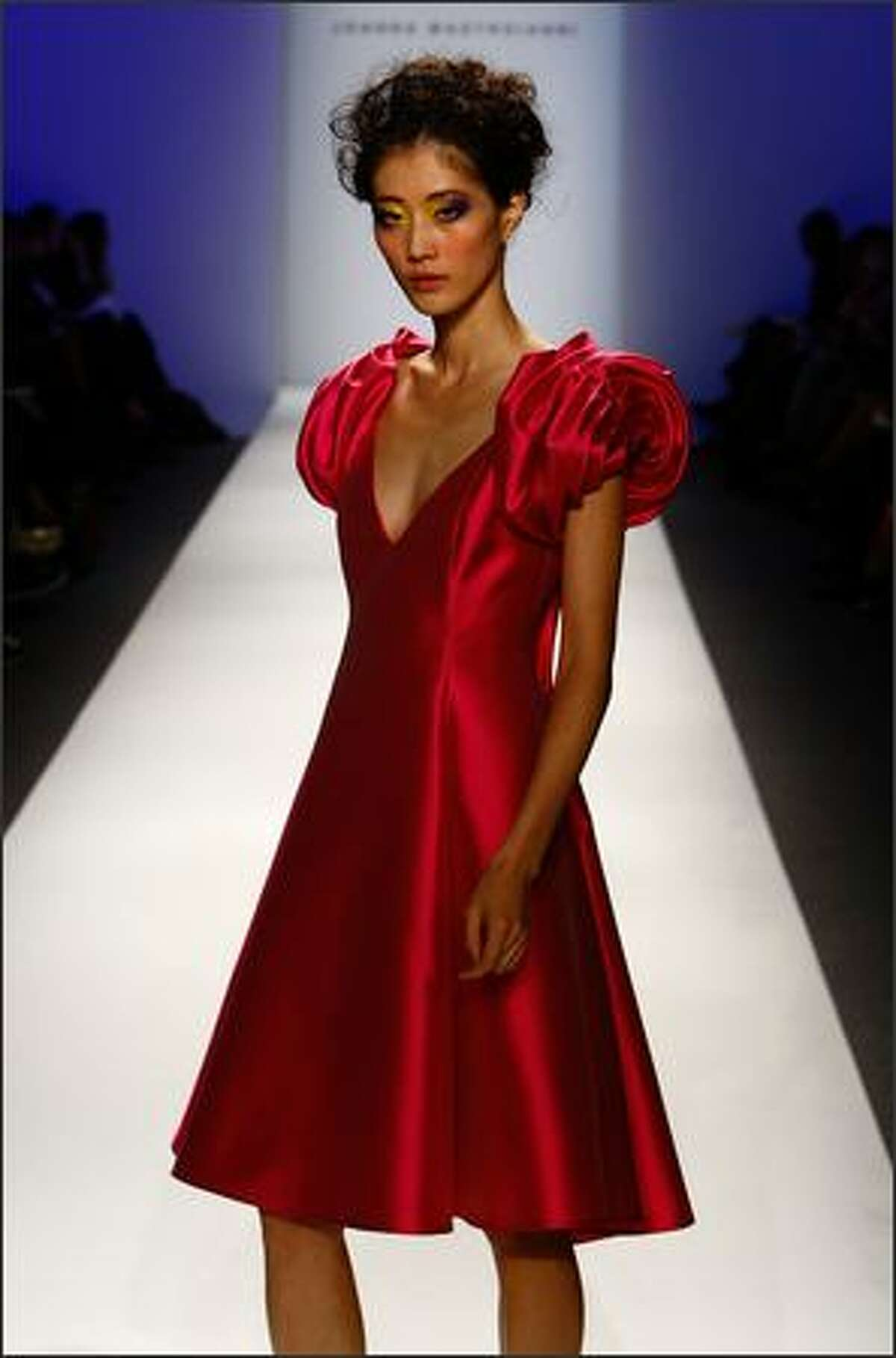 A model walks the runway at the Joanna Mastroianni show.