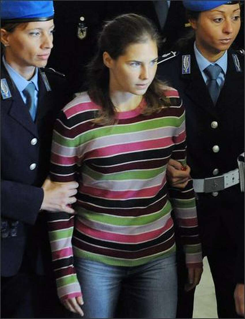 One of the three suspects in the murder of British student Meredith Kercher, Amanda Knox, arrives at a court hearing in Perugia on Sept. 27.