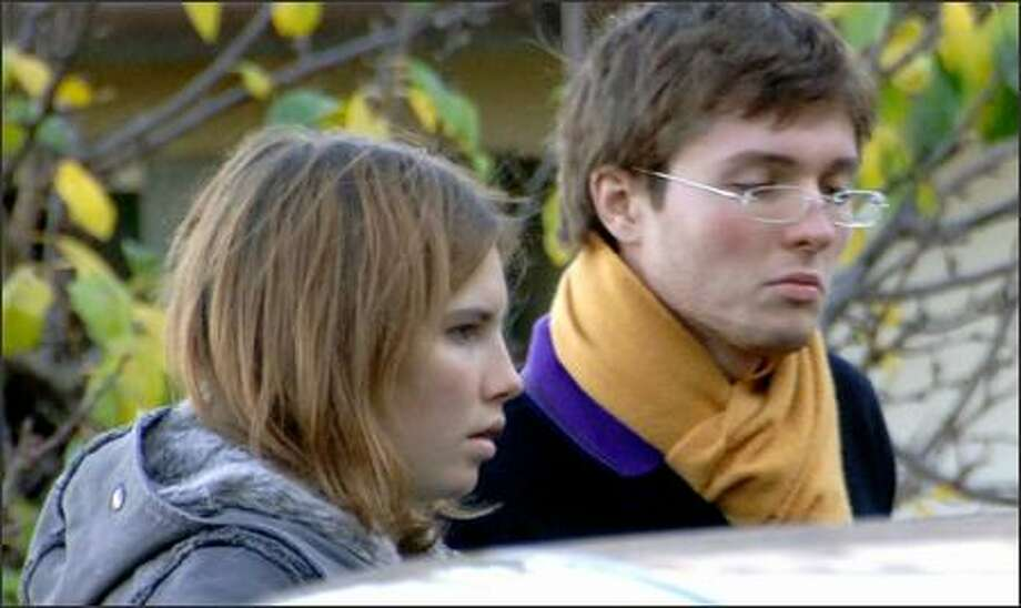 Amanda Knox and boyfriend Raffaele Sollecito of Italy are shown outside the house in Perugia where Knox's roommate was found slain. Photo: Associated Press