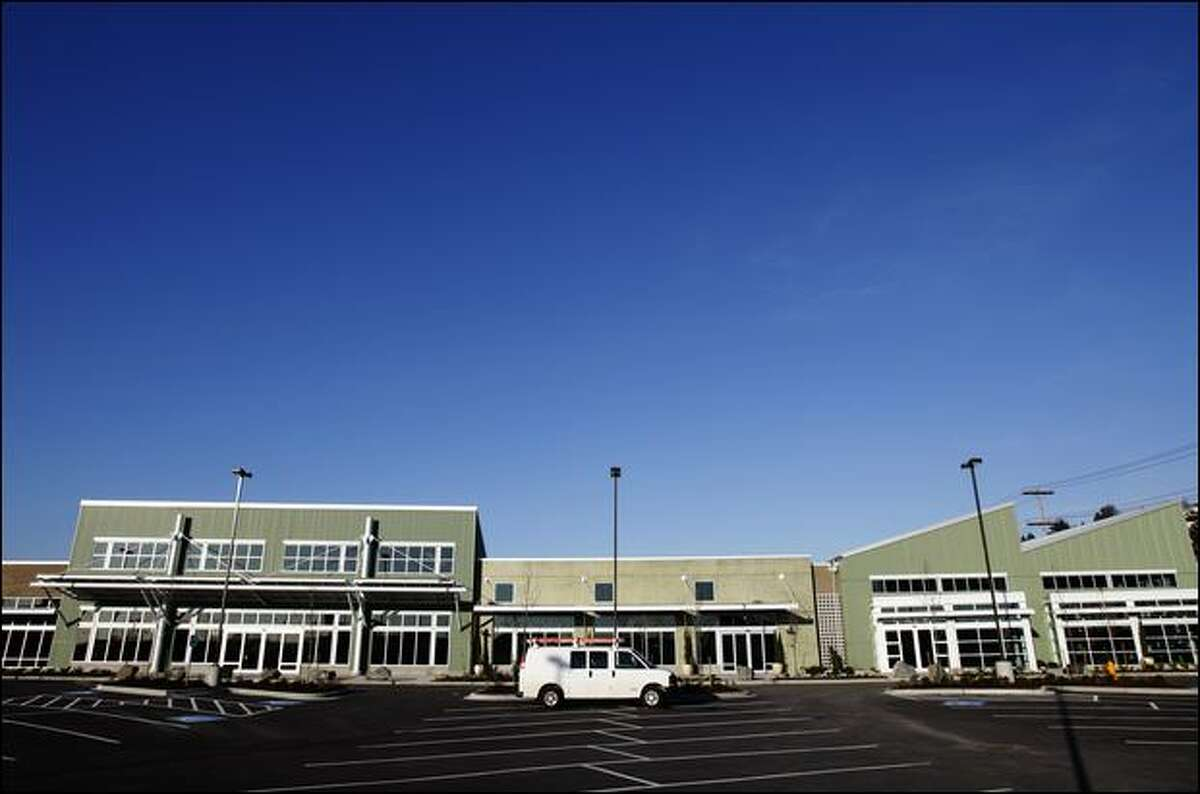 At this shopping center on 15th Avenue West, the anchor tenant, Whole Foods, broke its lease, triggering a lawsuit.