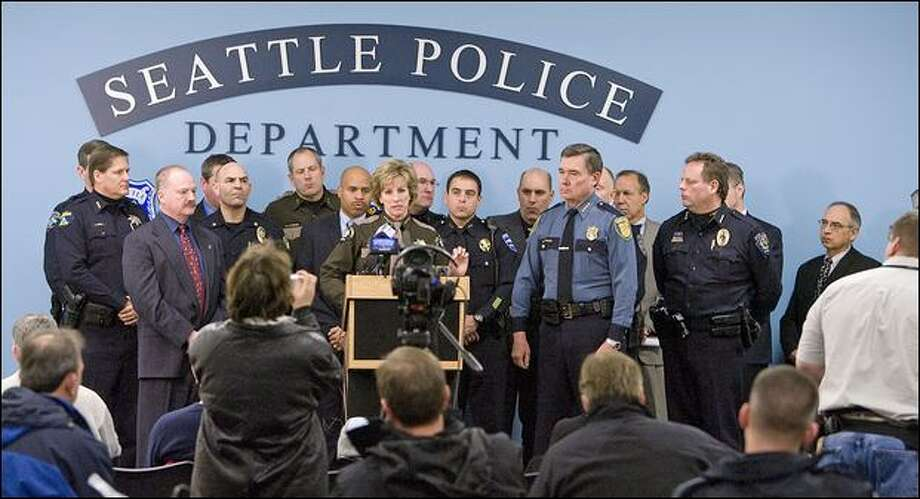 Law enforcement officials gathered Tuesday to pledge new collaborative efforts to fight gangs. Photo: Grant M. Haller/Seattle Post-Intelligencer