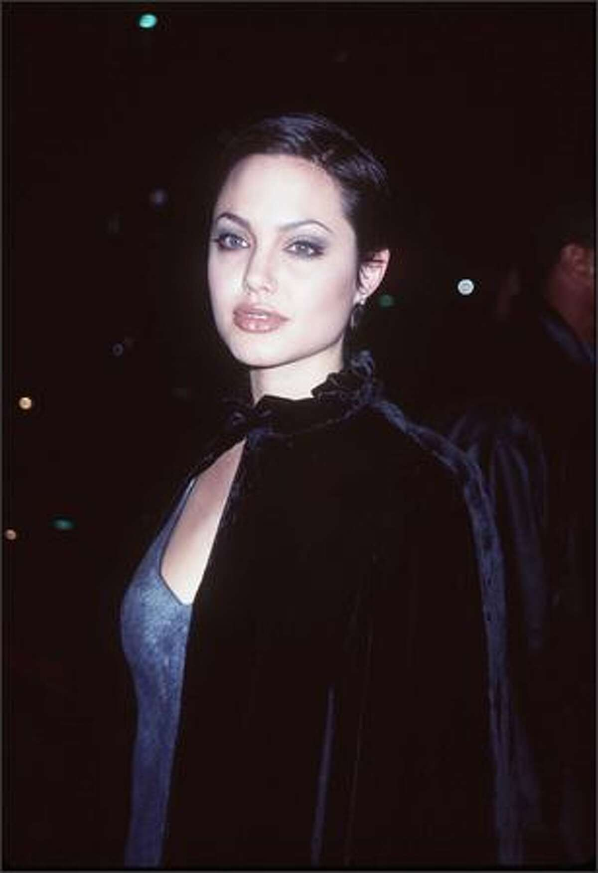 This is the 10th in an occasional series featuring stars and their ever-changing fashion styles. Angelina Jolie, now 33, is seen here at the Cable Ace Awards in Los Angeles, Nov. 15, 1997, in the early stages of a film career that has since led to an Academy Award and three Golden Globe Awards.