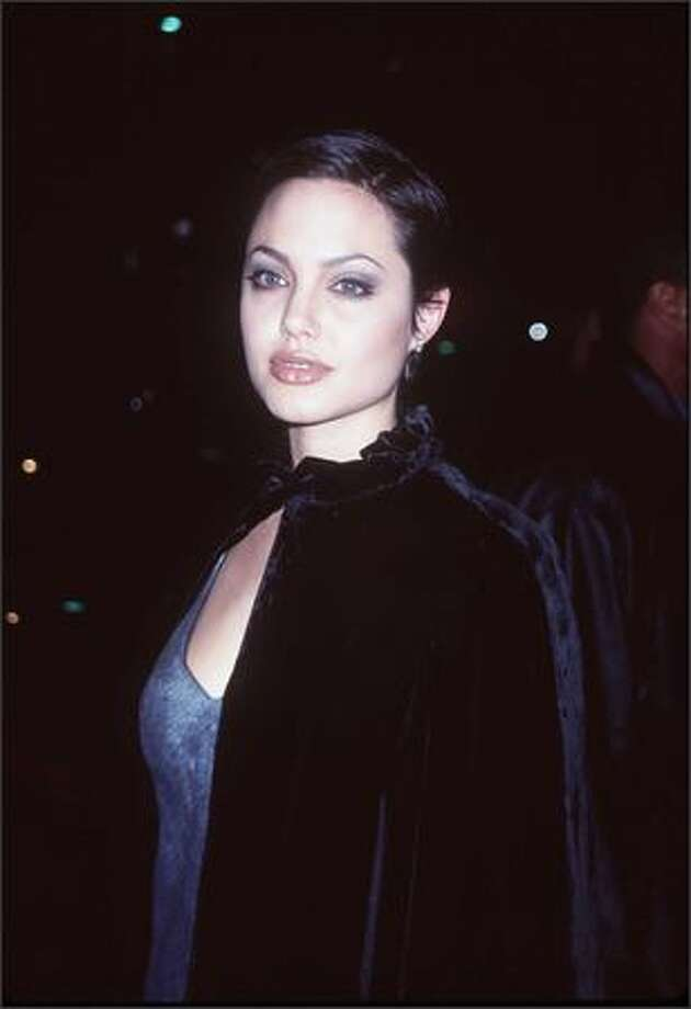 This is the 10th in an occasional series featuring stars and their ever-changing fashion styles. Angelina Jolie, now 33, is seen here at the Cable Ace Awards in Los Angeles, Nov. 15, 1997, in the early stages of a film career that has since led to an Academy Award and three Golden Globe Awards. Photo: Getty Images