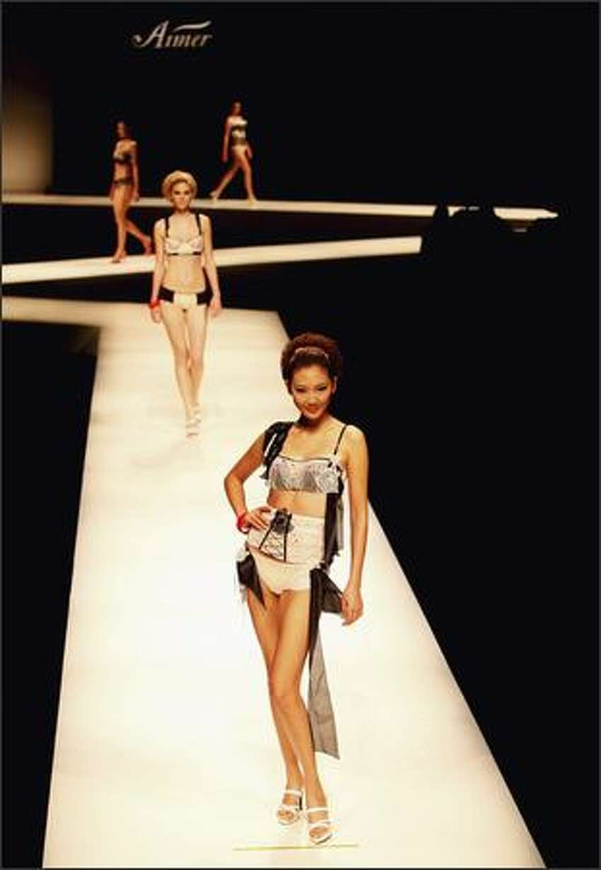 Models pose on the runway during the Aimer Lingerie Trends Release S/S 2009 at the China Fashion Week Spring/Summer Collection 2009 on Tuesday in Beijing, China.