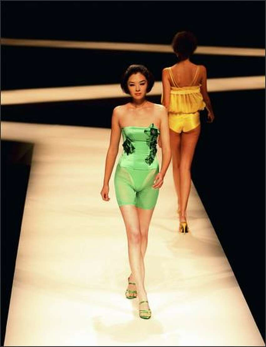 Models walk on the runway during the Aimer Lingerie Trends Release S/S 2009 at the China Fashion Week Spring/Summer Collection 2009 on Tuesday in Beijing, China.