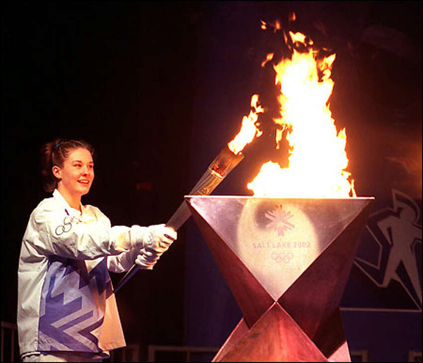 Megan Quann, a gold medalist in the 2002 Summer Games in Sydney, Australia, lit the Olympic flame at the Seattle Center on Jan. 23 prior to the running of the Torch Relay through the streets of Seattle.