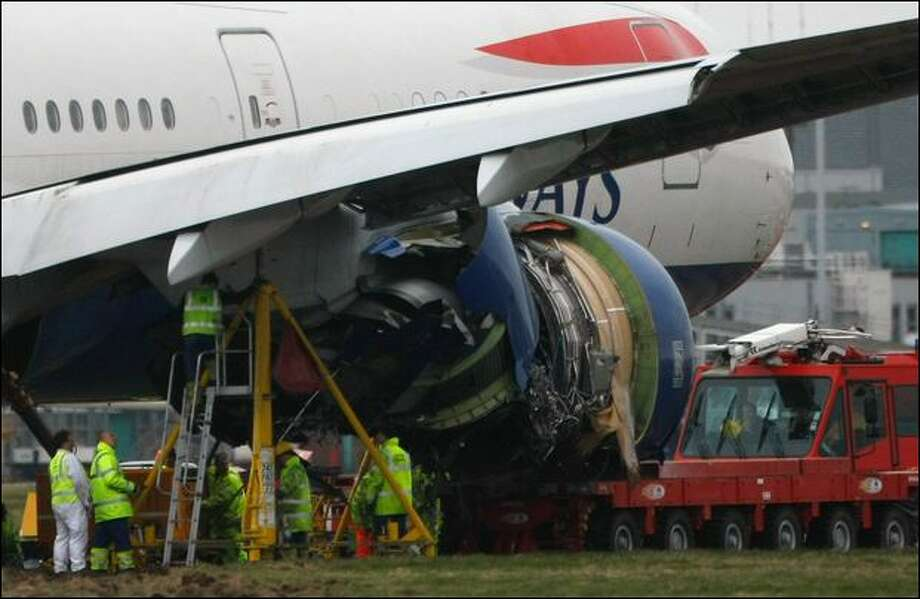A Boeing 777 engine is moved Jan. 20 after the plane crashed at London's Heathrow Airport. Photo: Getty Images/File